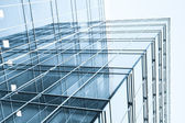 Glass wall with placard of skyscraper — Stock Photo