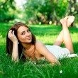 Girl relaxing in spring park — Stock Photo
