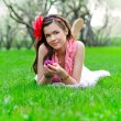 Portrait of teenage girl in park — Stock Photo