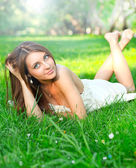 Girl relaxing on the lawn — Stock Photo