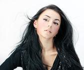 Sensual young woman with beautiful long brown hairs — Stock Photo