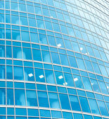 Turquoise texture of glass high-rise building — Stock Photo