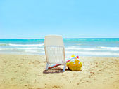 Chair under umbrella on beautiful beach — Stockfoto