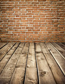 Grungy stone wall and wooden floor — Stockfoto