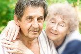 Elderly hugging — Stock Photo