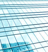 Wide angle textured glass windows with blue sky reverberation — Stock Photo