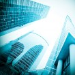 Stock Photo: Low angle view to blue contemporary glass skyscraprs