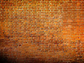 Grungy textured red brick and stone wall inside old neglected an — Stock Photo