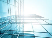 Underside view to steel glass high-rise building — Stock Photo