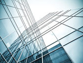 Underside view to steel glass high rise building — Stock Photo