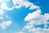 White sparse clouds over blue sky — Stock Photo
