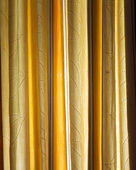 Dense yellow textile curtain background with folds — Stock Photo