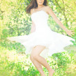 Young woman dancing in orchard — Stock Photo