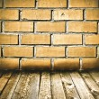 Brick wall and wooden floor — Stock Photo