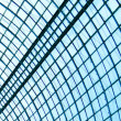 View to steel blue glass airport ceiling through high rise building skyscrapers — Stock Photo