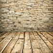 Stone wall and wooden floor — Stock Photo