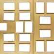 Set of vintage golden picture frames, isolated over wooden stand board — Stock Photo