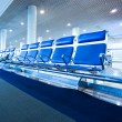 blue spacious hallway of airport, waiting room with seats — Stock Photo