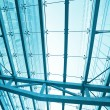 Perspective view to steel blue glass airport ceiling — Stock Photo #25384909