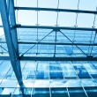 Perspective view to steel blue glass airport ceiling — Stock Photo