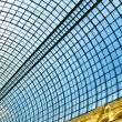 Underside wide angled and perspective view to steel blue glass airport ceiling — Stock Photo #25386933