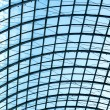 Underside wide angled and perspective view to steel blue glass airport ceiling — Stock Photo #25386963