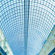 Underside wide angled and perspective view to steel blue glass airport ceiling — Stock Photo #25386969