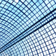 Underside wide angled and perspective view to steel blue glass airport ceiling — Stock Photo #25387081