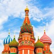 The most famous architectural place for visiting and attraction in Moscow, Russia, Saint Basil's cathedral with colorful cupolas and spectacular domes in traditional culture on cloudy blue sky — Stock Photo #25388217