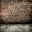 Background of aged grungy textured white brick and stone wall with light wooden floor with whiteboard inside old neglected and deserted empty interior, blank horizontal space of clean studio room — Stock Photo #25388587