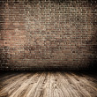 Background of aged grungy textured white brick and stone wall with light wooden floor with whiteboard inside old neglected and deserted empty interior, blank horizontal space of clean studio room — Stock Photo #25388739
