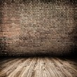 Stock Photo: Background of aged grungy textured white brick and stone wall with light wooden floor with whiteboard inside old neglected and deserted empty interior, blank horizontal space of clestudio room