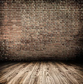 Background of aged grungy textured white brick and stone wall with light wooden floor with whiteboard inside old neglected and deserted empty interior, blank horizontal space of clean studio room — Foto Stock