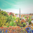The Famous Summer Park Guell over bright blue sky in Barcelona, — Stockfoto