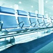 Business and transportation background of contemporary blue spacious hallway of airport, waiting room with seats — Stock Photo