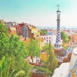The Famous Summer Park Guell over bright blue sky in Barcelona, — Stock Photo #25398457