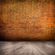 Stock Photo: Empty black old spacious room with stone grungy wall and wooden weathered dirty floor, vintage background texture of brickwall
