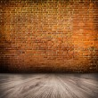 Empty black old spacious room with stone grungy wall and wooden weathered dirty floor, vintage background texture of brickwall — Stock Photo