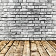 Empty old spacious room with stone grungy wall and wooden weathered dirty floor, vintage background texture of brickwall — Stock Photo