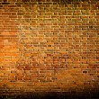 Grungy textured red stone wall inside old neglected and deserted — Foto Stock #25415383