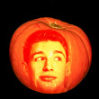 Mysterious pumpkin with face of man isolated on black background — Stock Photo #25415991