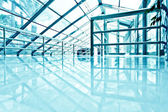 Underside wide angled and perspective view to steel blue glass a — Stock Photo