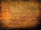Grungy textured red stone wall inside old neglected and deserted — Stock Photo