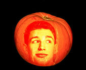 Mysterious pumpkin with face of man isolated on black background — Stock Photo