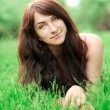 Portrait of beautiful young womrelaxing in summer park — Stockfoto #25424823
