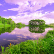 Stock Photo: Beautiful evening picturesque scene of rural lake