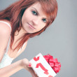 Surprised beautiful woman with festive sweet gift box — Stock Photo #25425691