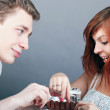 Young happy couple eating chocolate at celebration — Stock Photo