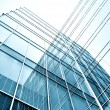 Transparent glass wall of office building — Stock Photo #25426573