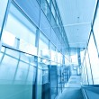 Transparent glass wall of office building — Stock Photo #25426583